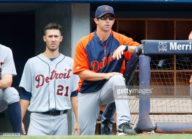 Manager Brad Ausmus and Rick Porcello of the Detroit Tigers look on against the New York Yankees at Yankee Stadium on August 7 2014 in the Bronx...