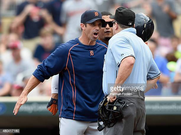 Manager Brad Ausmus of the Detroit Tigers gets between Victor Martinez and home plate umpire Marty Foster after Martinez was ejected during the fifth...