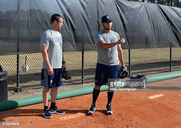 Manager Brad Ausmus of the Detroit Tigers talks with pitcher Anibal Sanchez during a Spring Training workout day at the TigerTown Facility on...