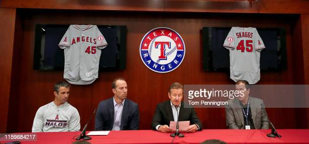 Manager Brad Ausmus of the Los Angeles Angels General Manager Billy Eppler team owner Arte Moreno and team President John Carpino talk with the media...
