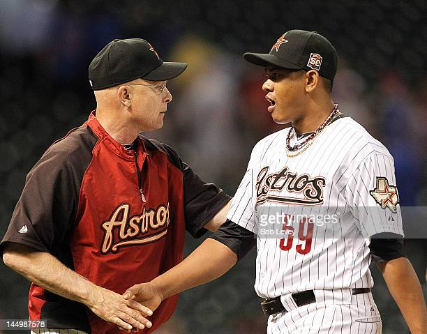 Manager Brad Mills of the Houston Astros shakes hands with Wilton Lopez after getting the final out of the game against the Chicago Cubs at Minute...