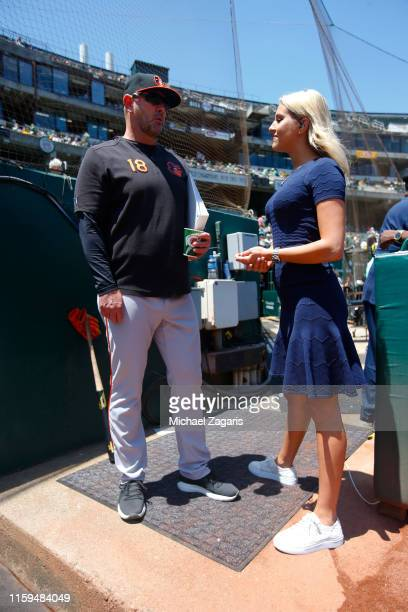 Manager Brandon Hyde of the Baltimore Orioles talks with MASN sideline reporter Sara Perlman in the dugout prior to the game against the Oakland...