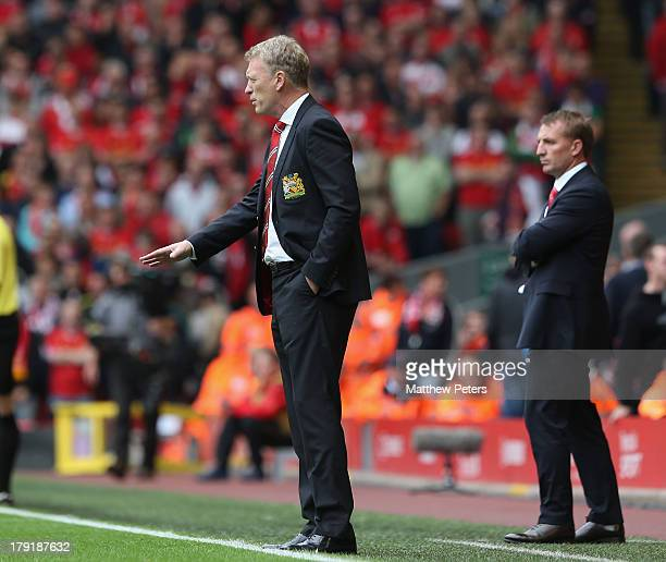 Manager Brendan Rodgers of Liverpool and Manager David Moyes of Manchester United watch from the touchline during the Barclays Premier League match...