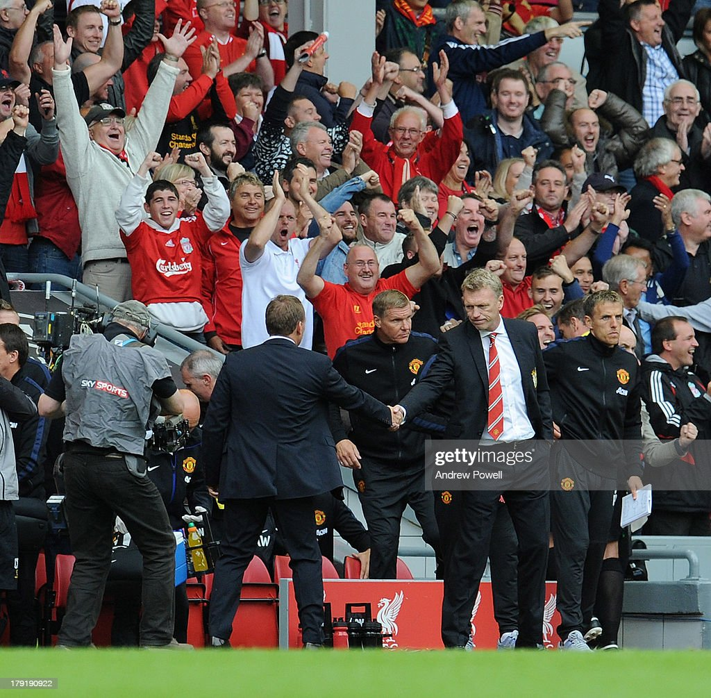 Manager Brendan Rodgers of Liverpool and manager David Moyes of Manchester United shake hands at the end of the Barclays Premier League match between Liverpool and Manchester United at Anfield on September 01, 2013 in Liverpool, England.