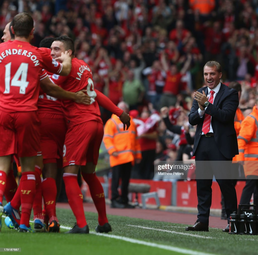Manager Brendan Rodgers of Liverpool applauds Daniel Sturridge for scoring their first goal during the Barclays Premier League match between Liverpool and Manchester United at Anfield on September 01, 2013 in Liverpool, England.