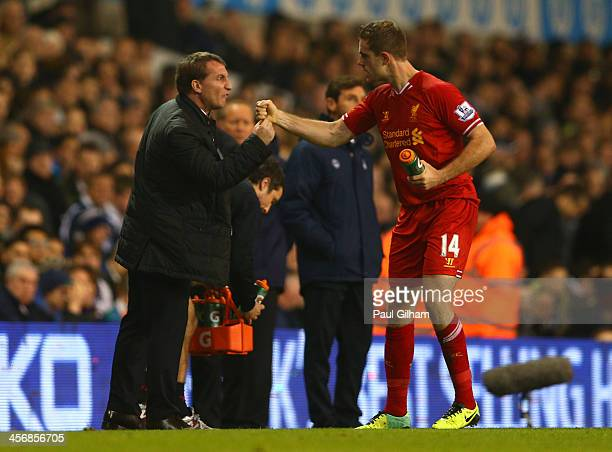 Manager Brendan Rodgers of Liverpool congratulates Jordan Henderson of Liverpool on scoring their second goal during the Barclays Premier League...