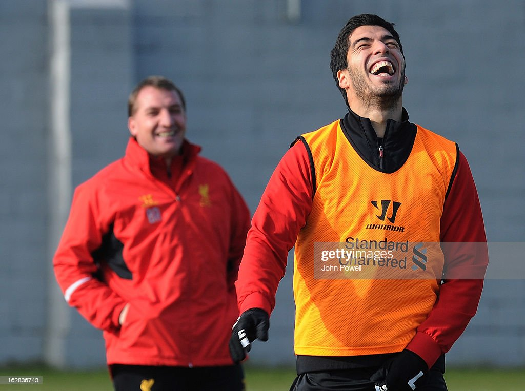 Manager Brendan Rodgers of Liverpool FC shares a laugh with Luis Suarez during a training session at Melwood Training Ground on February 28, 2013 in Liverpool, England.