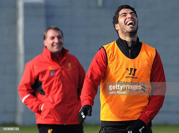 Manager Brendan Rodgers of Liverpool FC shares a laugh with Luis Suarez during a training session at Melwood Training Ground on February 28, 2013 in...