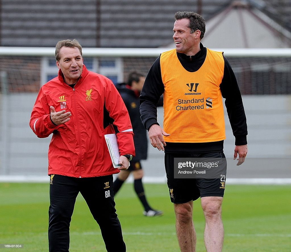 Manager Brendan Rodgers of Liverpool talks with Jamie Carragher (R) during a training session at Melwood Training Ground on May 10, 2013 in Liverpool, England.