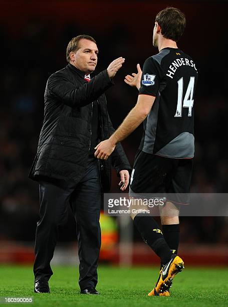 Manager Brendan Rogers of Liverpool shakes hands with Jordan Henderson of Liverpool at the final whistle during the Barclays Premier League match...