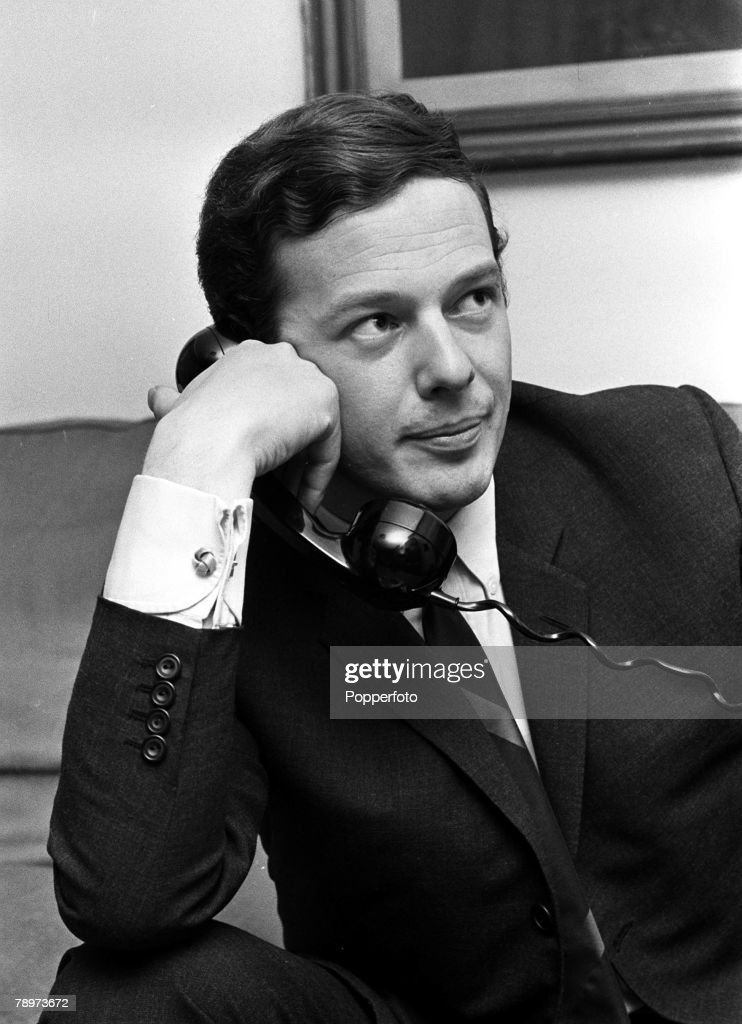 Manager Brian Epstein, manager of various 1960's pop groups including The Beatles, speaking on the telephone, 1965. : News Photo