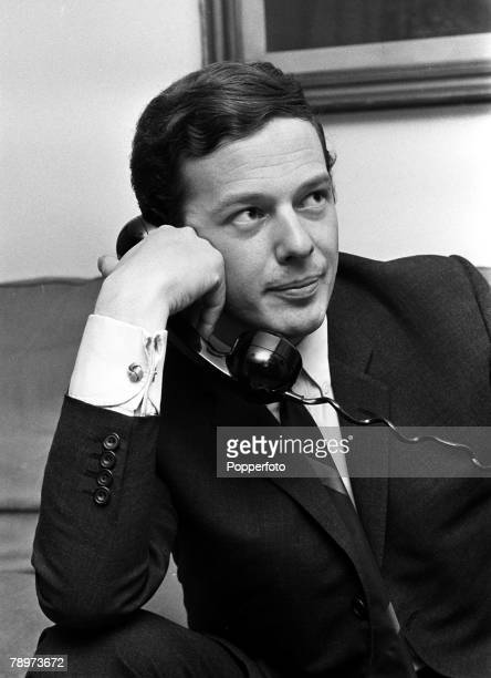 Manager Brian Epstein, manager of various 1960's pop groups including The Beatles, speaking on the telephone, 1965
