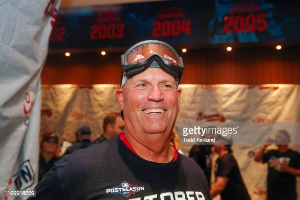 Manager Brian Snitker of the Atlanta Braves celebrates in the clubhouse at the conclusion of an MLB game against the San Francisco Giants in which...