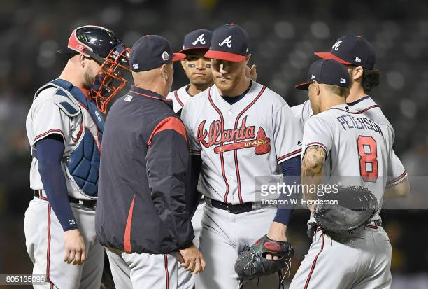 Manager Brian Snitker of the Atlanta Braves takes the ball from starting pitcher Mike Foltynewicz taking Foltynewicz out of the game against the...