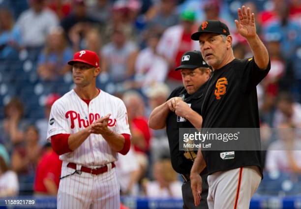 Manager Bruce Bochy of the San Francisco Giants acknowledges the crowd as Gabe Kapler of the Philadelphia Phillies applauds him prior to the game at...