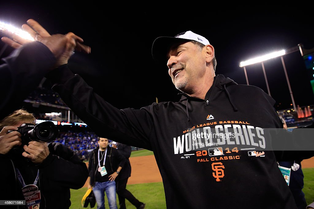Manager Bruce Bochy #15 of the San Francisco Giants celebrates on the field after defeating the Kansas City Royals 3-2 to win Game Seven of the 2014 World Series at Kauffman Stadium on October 29, 2014 in Kansas City, Missouri.