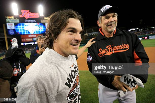 Manager Bruce Bochy of the San Francisco Giants celebrates with Ryan Theriot after defeating the Detroit Tigers to win Game Four of the Major League...