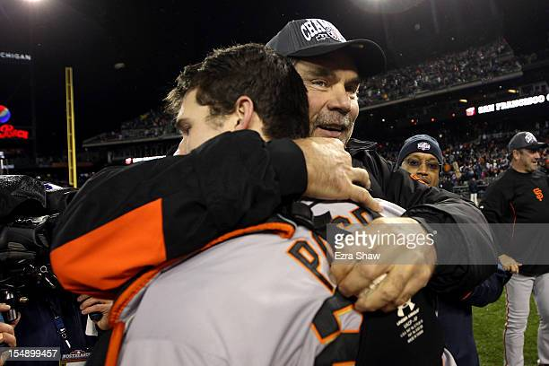 Manager Bruce Bochy of the San Francisco Giants hugs Buster Posey after defeating the Detroit Tigers to win Game Four of the Major League Baseball...
