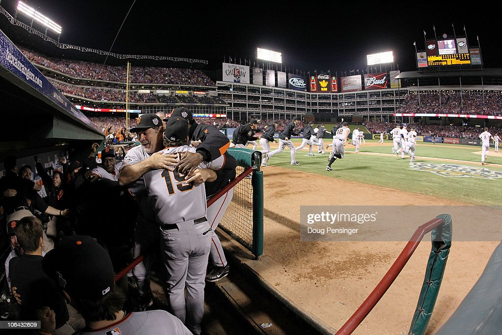 Manager Bruce Bochy #15 of the San Francisco Giants hugs Dave Righetti #19 after their 3-1 victory to win the World Series over the Texas Rangers in Game Five of the 2010 MLB World Series at Rangers Ballpark in Arlington on November 1, 2010 in Arlington, Texas.