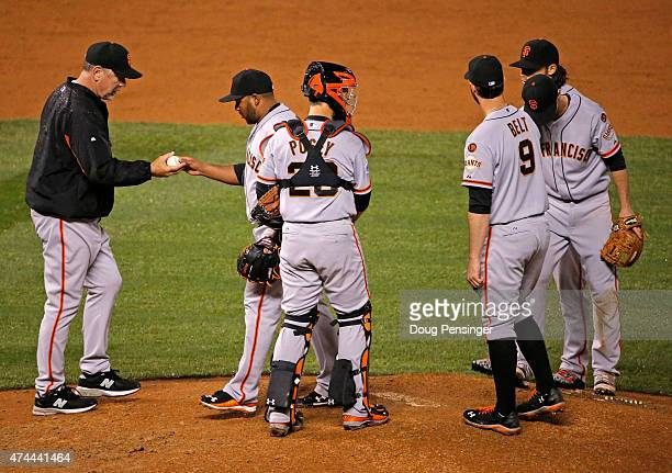 Manager Bruce Bochy of the San Francisco Giants removes relief pitcher Jean Machi of the San Francisco Giants from the game against the Colorado...