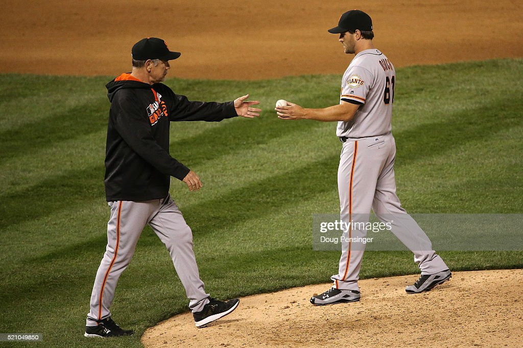 Manager Bruce Bochy #15 of the San Francisco Giants removes relief pitcher Josh Osich #61 from the game against the Colorado Rockies in the eighth inning at Coors Field on April 13, 2016 in Denver, Colorado. The Rockies defeated the Gaints 10-6.