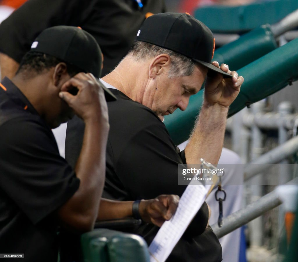 Manager Bruce Bochy #15 of the San Francisco Giants sits in the dugout during the seventh inning of a game against the Detroit Tigers at Comerica Park on July 5, 2017 in Detroit, Michigan. The Giants defeated the Tigers 5-4.