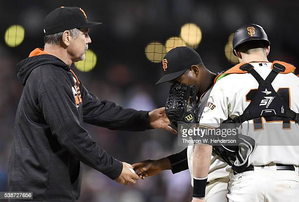 Manager Bruce Bochy of the San Francisco Giants takes pitcher Santiago Casilla out of the game against the Boston Red Sox in the top of the 10th...