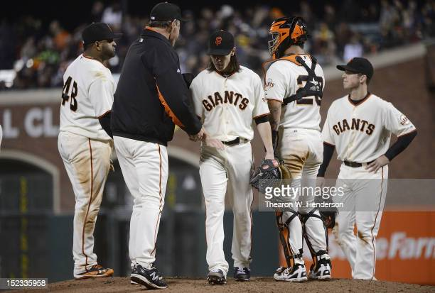 Manager Bruce Bochy of the San Francisco Giants takes the ball from pitcher Tim Lincecum taking him out of the game while teammates Pablo Sandoval...