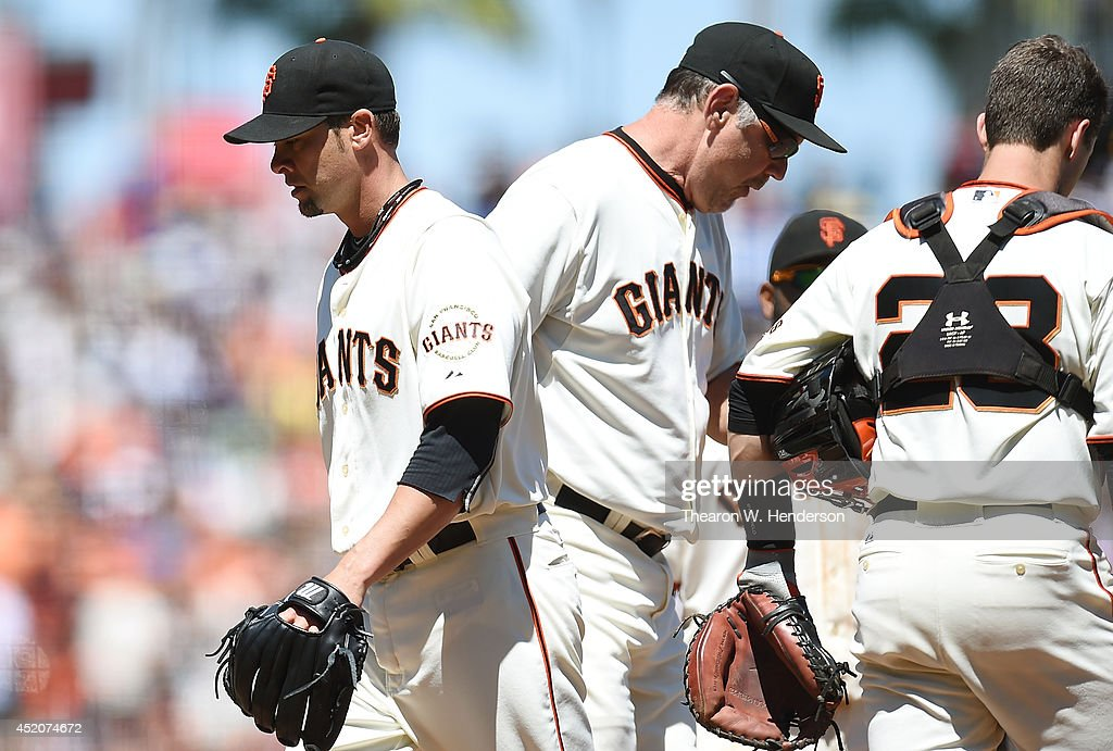Manager Bruce Bochy #15 of the San Francisco Giants takes the ball from starting pitcher Ryan Vogelsong #32 taking Vogelsong out of the game in the top of the seventh inning against the Arizona Diamondbacks at AT&T Park on July 12, 2014 in San Francisco, California.
