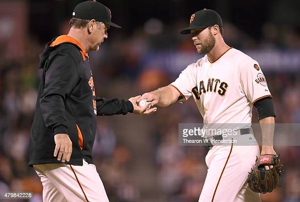 Manager Bruce Bochy of the San Francisco Giants takes the ball from Hunter Strickland taken him out of the game against the New York Mets in the top...
