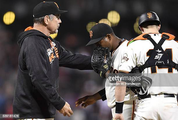 Manager Bruce Bochy of the San Francisco Giants takes the ball from Santiago Casilla taking Casilla out of the game against the Boston Red Sox in the...