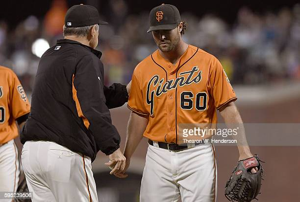Manager Bruce Bochy of the San Francisco Giants takes the ball from Hunter Strickland taking him out of the game against the New York Mets in the top...