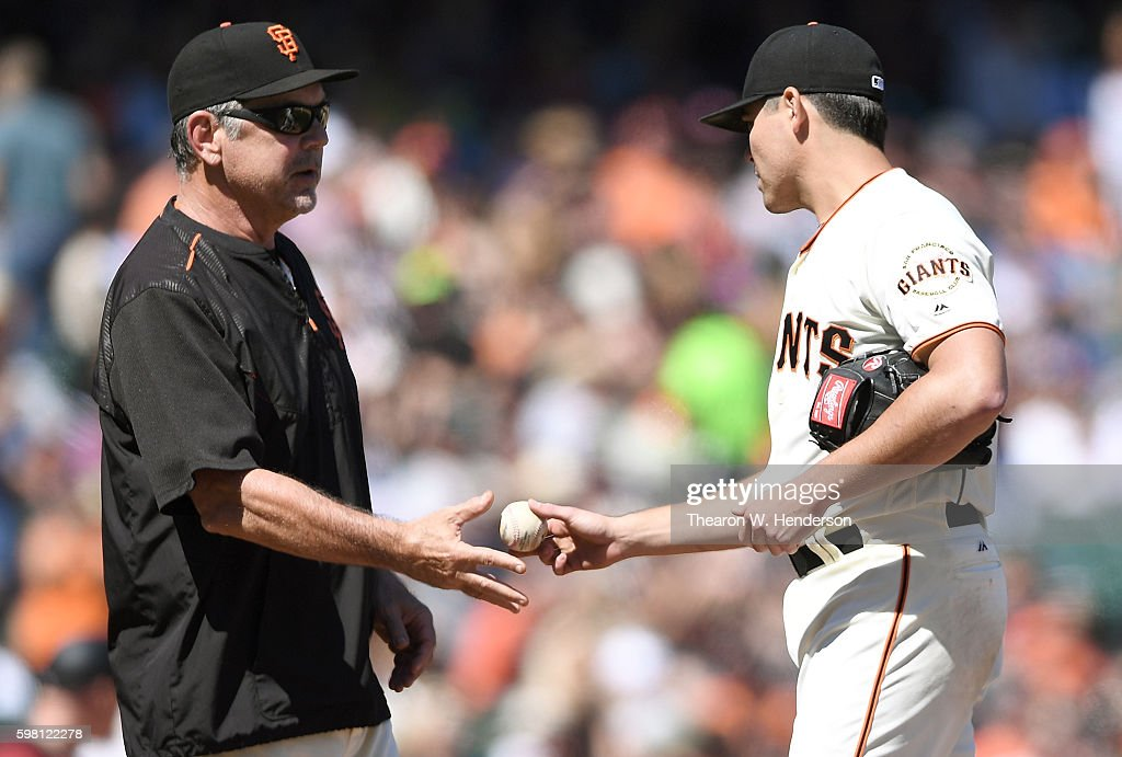 Manager Bruce Bochy #15 of the San Francisco Giants takes the ball from starting pitcher Matt Moore #45 after taking him out of the game in the top of the six inning against the Arizona Diamondbacks at AT&T Park on August 31, 2016 in San Francisco, California.