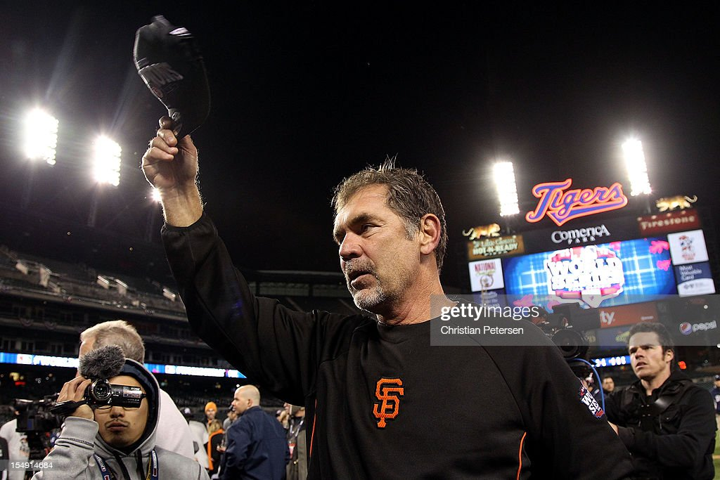 Manager Bruce Bochy #15 of the San Francisco Giants tips his hat to the crowd after defeating the Detroit Tigers to win Game Four of the Major League Baseball World Series at Comerica Park on October 28, 2012 in Detroit, Michigan. The San Francisco Giants defeated the Detroit Tigers 4-3 in the tenth inning to win the World Series in 4 straight games.