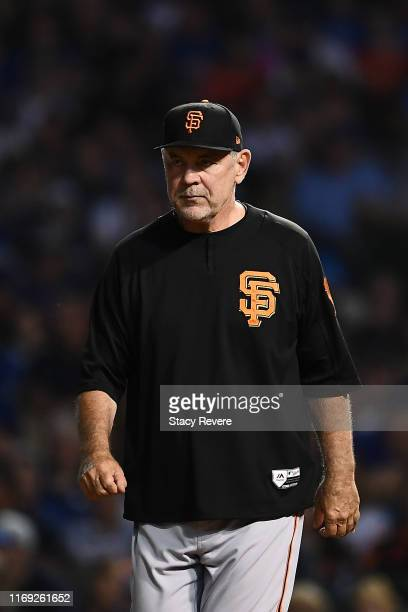 Manager Bruce Bochy of the San Francisco Giants walks to the mound during the sixth inning against the Chicago Cubs at Wrigley Field on August 20...