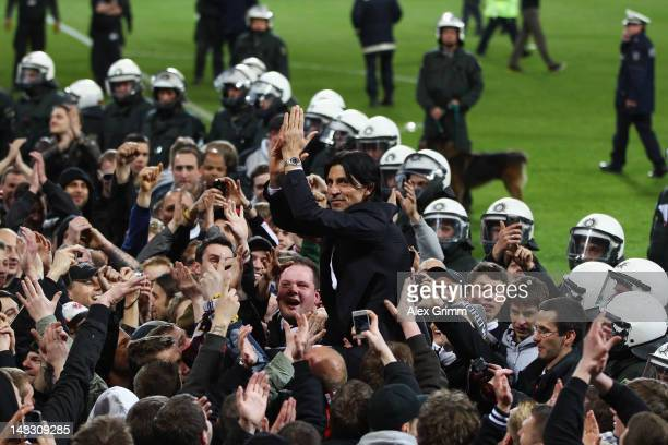 Manager Bruno Huebner of Frankfurt celebrates with supporters after the Second Bundesliga match between Alemannia Aachen and Eintracht Frankfurt at...