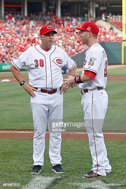 Manager Bryan Price of the Cincinnati Reds and Todd Frazier of the Cincinnati Reds talk before being honored for participating in the MLB AllStar...