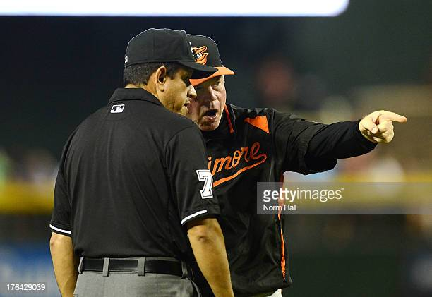 Manager Buck Showalter of the Baltimore Orioles argues a call with third base umpire Alfonso Marquez during the second inning against the Arizona...