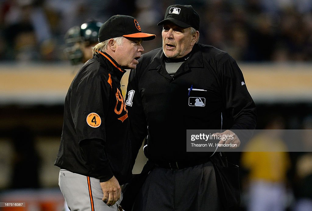 Manager Buck Showalter #16 of the Baltimore Orioles argues with home plate umpire Bob Davidson #61 over whether Chris Davis#19 of the Orioles was hit with a pitch against the Oakland Athletics in the third inning at O.co Coliseum on April 25, 2013 in Oakland, California. Davis was called back from first base to finish his at bat.