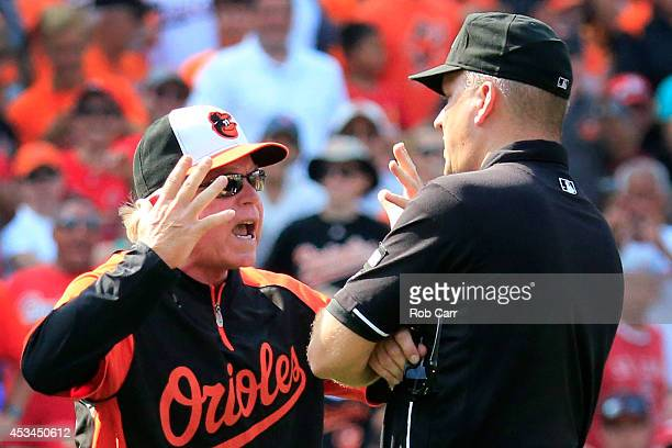 Manager Buck Showalter of the Baltimore Orioles argues with second base umpire Jeff Nelson after being ejected during the sixth inning against the St...