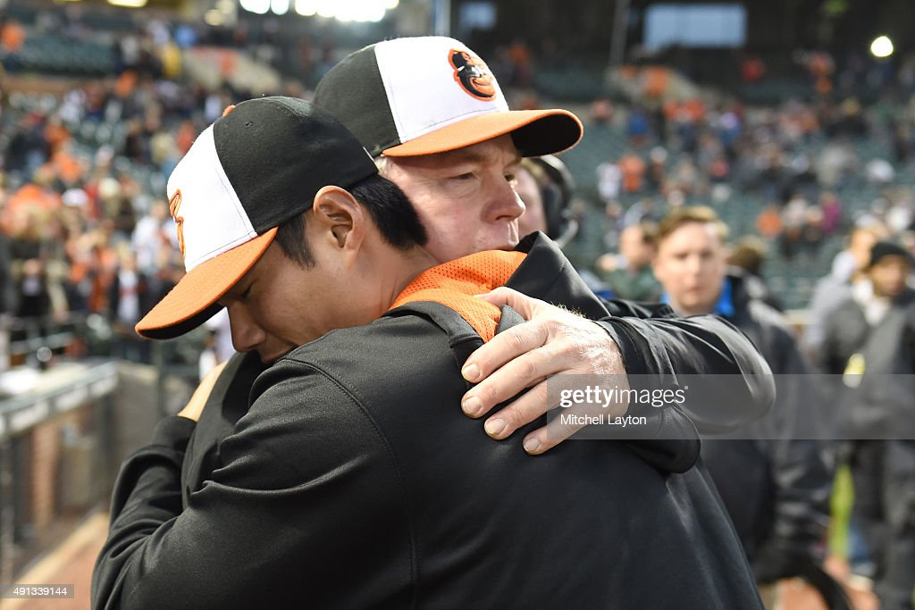Manager Buck Showalter #26 of the Baltimore Orioles hugs Wei-Yin Chen #16 after a baseball game against the New York Yankees at Oriole Park at Camden Yards on October 4, 2015 in Baltimore, Maryland. The Orioles won 9-4.