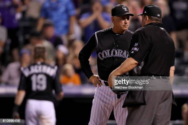 Manager Bud Black of the Colorado Rockies speaks with home plate umpire Sam Holbrook as Charlie Blackmon leaves the game after being ejected in the...
