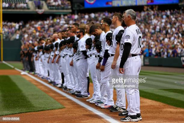 Manager Bud Black of the Colorado Rockies stands on the first base line with rest of the team as the National Anthem plays before taking on the Los...