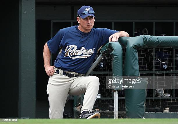 Manager Bud Black of the San Diego Padres looks on from the dugout during the spring training game against the Texas Rangers at Surprise Stadium on...