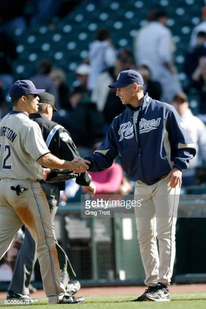 Manager Bud Black of the San Diego Padres shakes the hand of outfielder Scott Hairston of the San Diego Padres after a win against the San Francisco...
