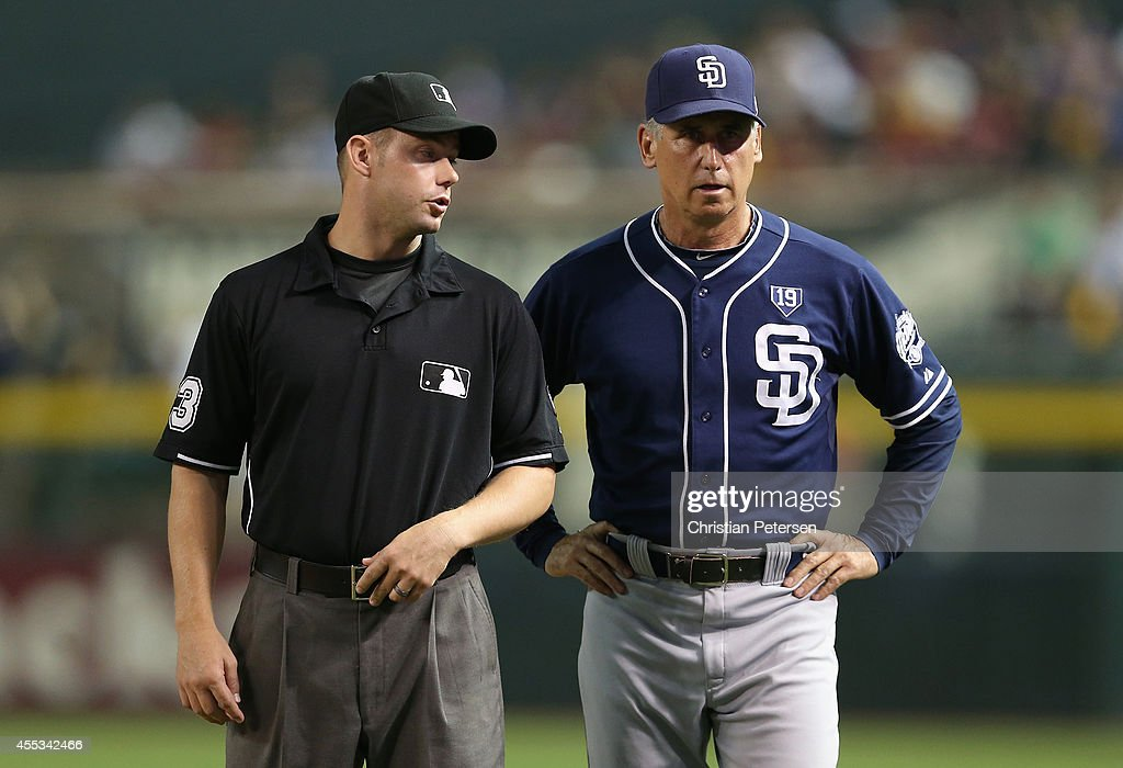 Manager Bud Black #20 of the San Diego Padres talks with first base umpire Will Little during the MLB game against the Arizona Diamondbacks at Chase Field on September 12, 2014 in Phoenix, Arizona.