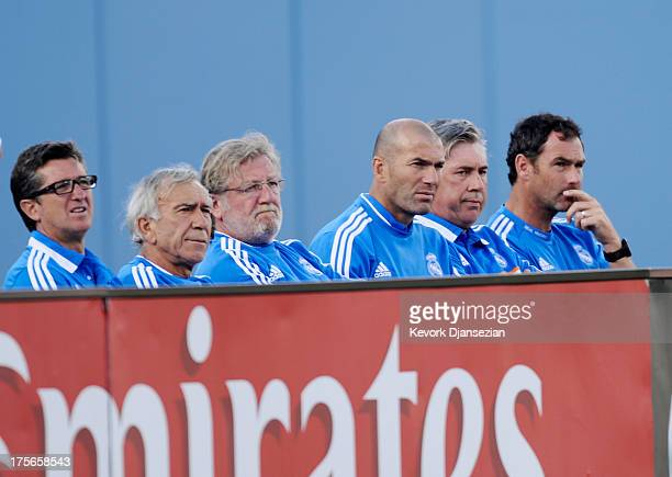 Manager Carlo Ancelotti of Real Madrid assistant coach Zinedine Zidane and the rest of the coaching staff during the second half of 2013 Guinness...