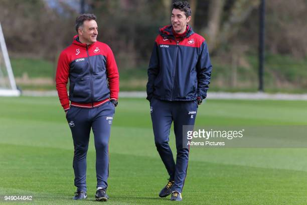 Manager Carlos Carvalhal and coach Bruno Lage watch the players train during the Swansea City Training at The Fairwood Training Ground on April 19...