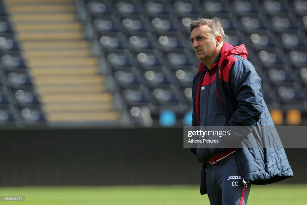 Manager Carlos Carvalhal watches his players train during the Swansea City Training at The Liberty Stadium on April 26, 2018 in Swansea, Wales.