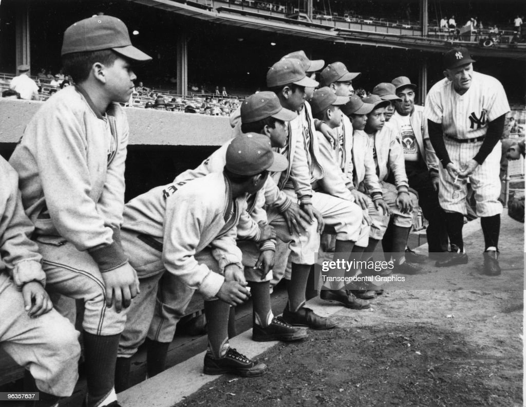 Manager Casey Stengel of the New York Yankees greets the Little League Champions of the World from Monterrey, Mexico at the dugout in Yankee Stadium before a game in 1954.